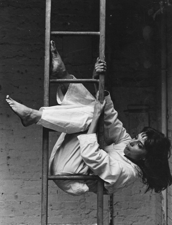 "Elaine Summers on a ladder in ""Theater Piece for Chairs and Ladders"", 1965. © by Dan Budnik"